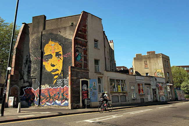 Evocative portrait fills two-story wall in Stokes Croft, in Bristol, England