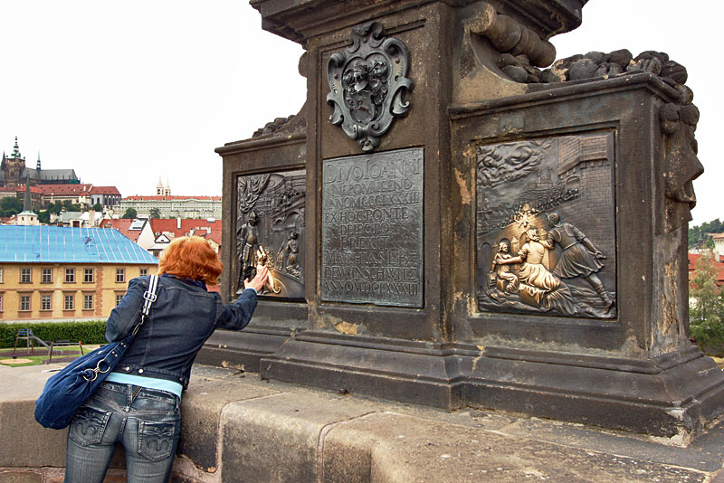 Rubbing Brass Plaques on the Charles Bridge in Prague is Said to Bring Luck or Ensure a Return to the City
