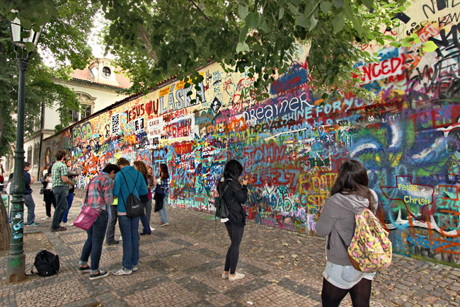 At the John Lennon wall in Prague, Czech Republic, visitors add sentiments about peace and love in homage to the musician