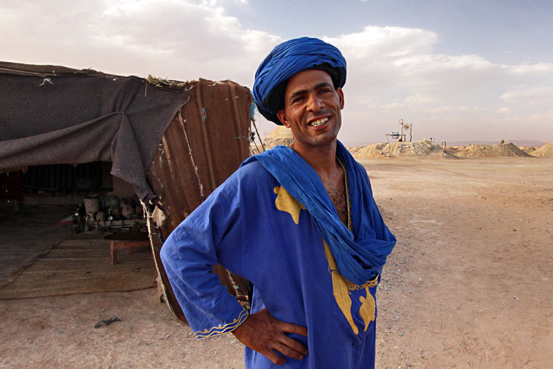 Blue Man of the Sahara Takes Visitors on a Tour of the Dry Wells at His Desert Camp in Morocco