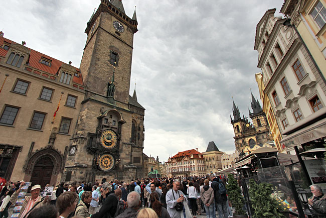 Crowds await the animated figures that emerge from the Astronomical Clock on the Old Town Hall tower in Prague