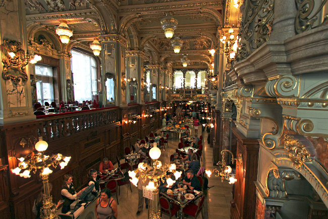 Opulent Italian Renaissance and Baroque decor at New York Cafe, one of Budapest's most famous coffee houses