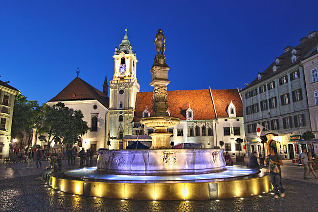 Primacialny Namestie (Primatial Square) in the historic center of Bratislava is artfully illuminated by night