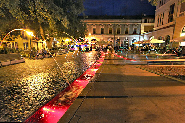 Fountains and neon-colored lights make Fish Sellers Square a popular night spot in Debrecen Hungary