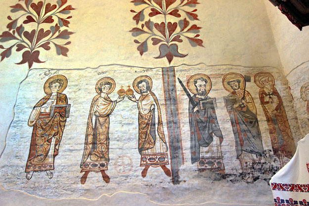 A layer of lime applied by Calvinists who took over the Csaroda church in 1595 covered and protected these medieval frescoes of apostles and saints from the 13th and 14th centuries