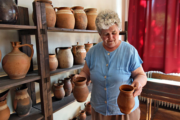 Margit Kormany displays some of the thousands of items in her museum that documents life in Penyige, Hungary
