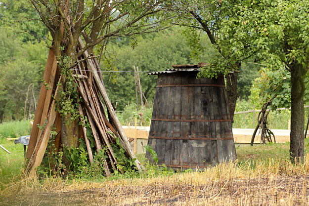 Giant wooden vats for fermenting apples into fruit brandy sit in every yard