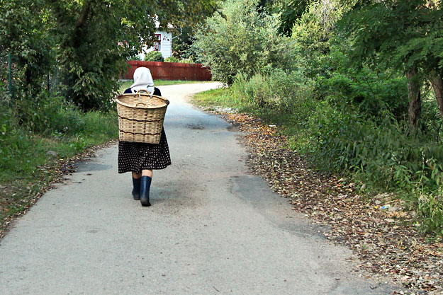Women walk everywhere and carry supplies on their backs in big wicker baskets