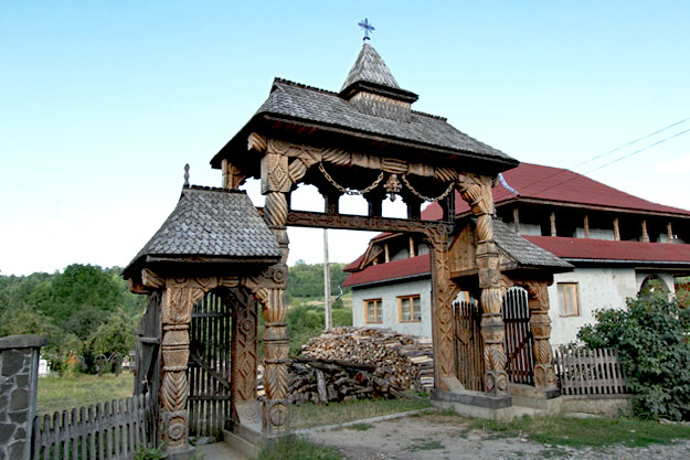 Traditional hand-carved wooden gate at the entrance of a home in Breb, Maramures, Romania