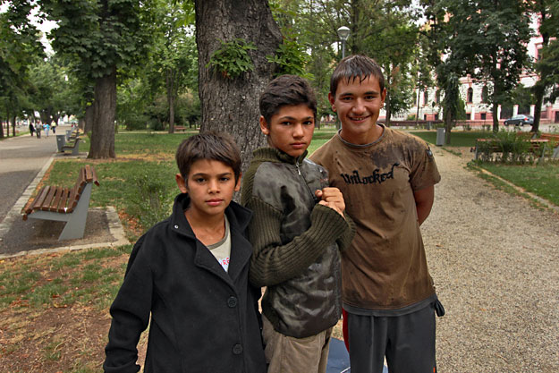 Roma boys pose for the camera in Simion Barnutiu Central Park
