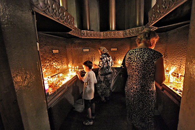 Lighting candles in Dormition of the Theotokos Orthodox Cathedral