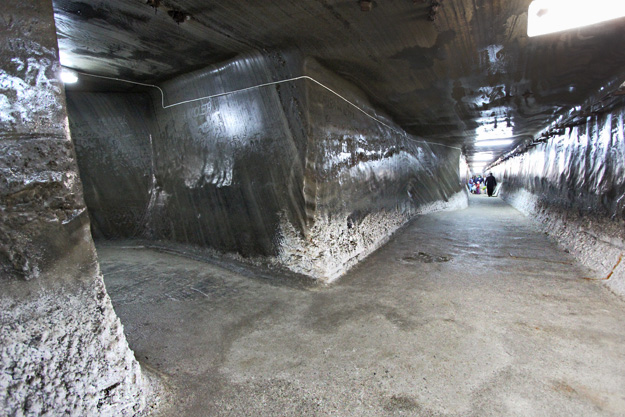 Deep beneath the surface, chilly temperatures make the salt walls of the Franz Josef Gallery at the Salina Turda Salt Mine sweat, turning them to slick black mirrors