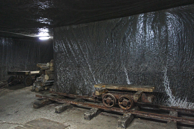 Rails and flatbed cars used to transport the block salt are displayed in the Crivac Room