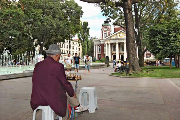 Man in Ivan Vasov Garden waits for an opponent to challenge him to a game of chess