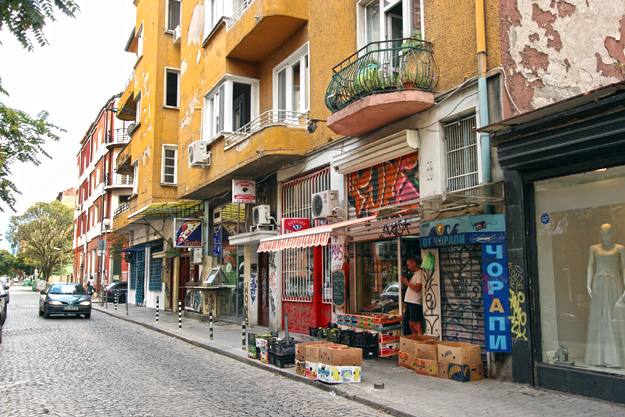 Typical street in Sofia Bulgaria city center, with shops, cafes, and fruit stands
