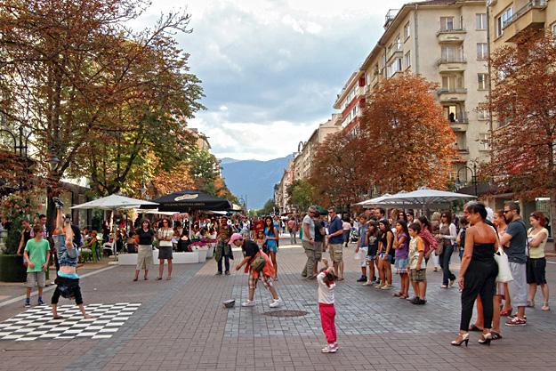Performers attract a crowd on Sofia's Vitosha Street pedestrian walkway Bulgaria