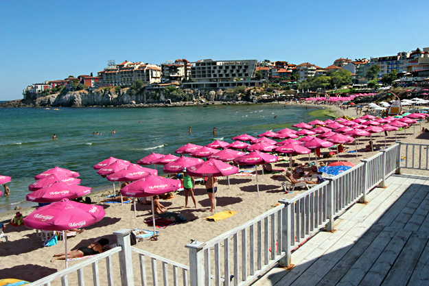 Main town beach in Sozopol is lined with colorful sun umbrellas