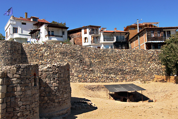 Mingling old with new, modern houses next to 200-year old stone and wooden cottages perch atop 5th century stone fortifications in Sozopol Bulgaria