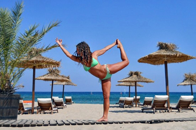 Sarah Astbury strikes a yoga pose on the beaches of Bulgaria