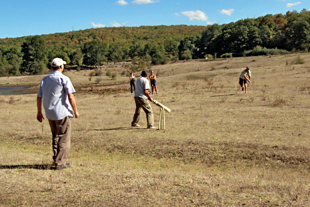Learning to play cricket at the lake near Yasna Polyana, Bulgaria