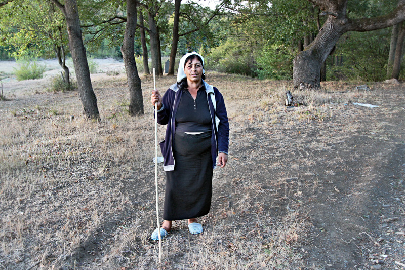 Woman Wears Traditional Costume of Shepherdess in the Small Village of Yasna Polyana, Bulgaria