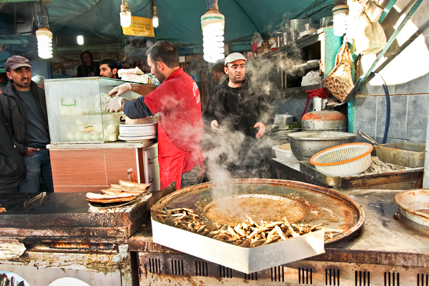 Outdoor cafes at the fish market at the foot of Galata Bridge fry up seafood fresh off the boat