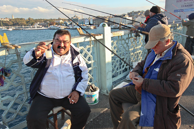 Fisherman on Galata Bridge toasts me