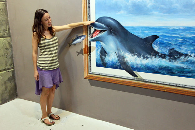 Paola pets a dolphin at Art in Paradise in Chiang Mai, Thailand