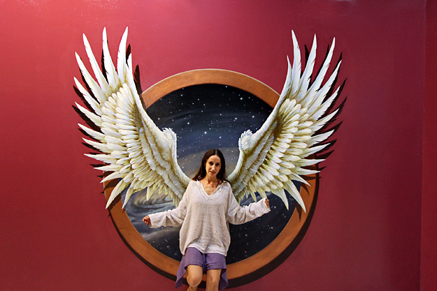 Angelic Paola poses against giant 3-D wings