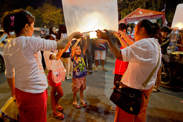 Whole families join in the fun of launching a lantern for luck in the coming year