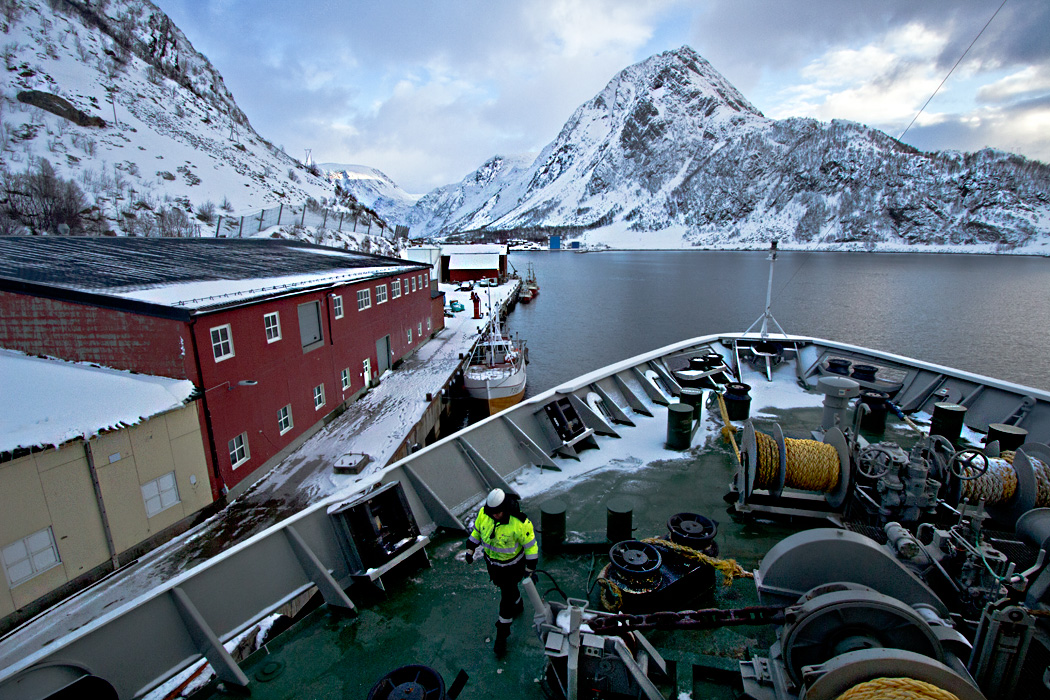 Hurtigruten ship, the MS Richard With, docks at Oksfjord Norway to deliver supplies to this tiny village above the Arctic Circle