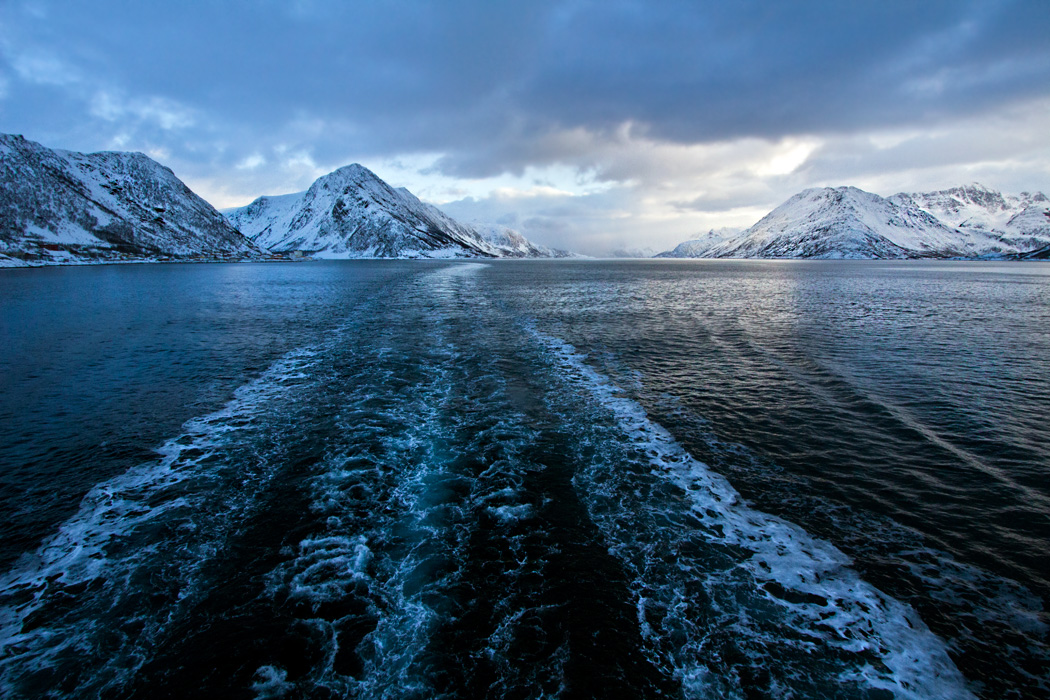 View from the aft of Hurtigruten's MS Richard With, while sailing between Oksfjord and Skjervoy Norway