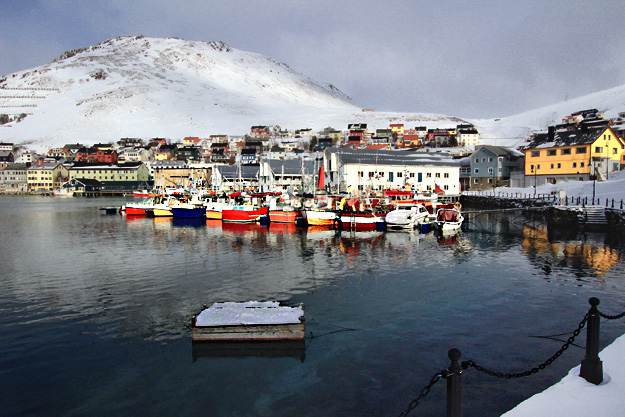Boats and houses add color to the white-on-white landscape