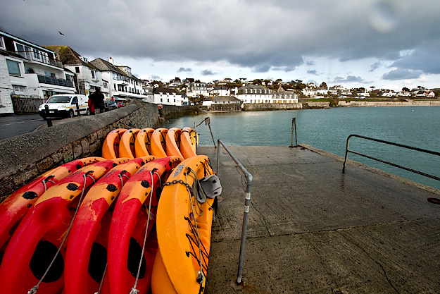Strolling along the waterfront in St. Mawes, Cornwall, England