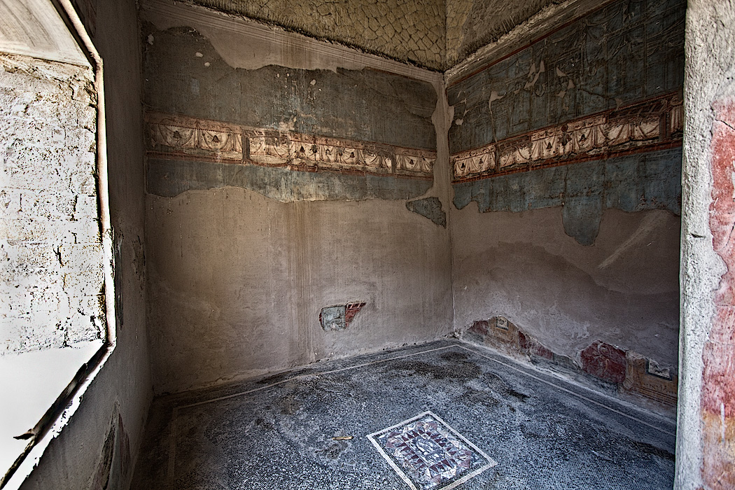Mosaic floor and wall frescoes in House with Large Portal in the Herculaneum ruins, Italy