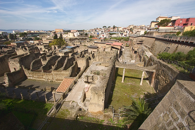Present day houses perch on the edge of the excavated ruins of Herculaneum, 75% of which still lies beneath 60 feet of volcanic ash and mud