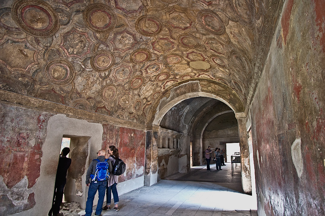 Intricate frescoes on the barrel vaulted plaster ceiling of the Stabian Baths in Pompeii. Public bath houses were an important part of the social structure in the ancient Roman city