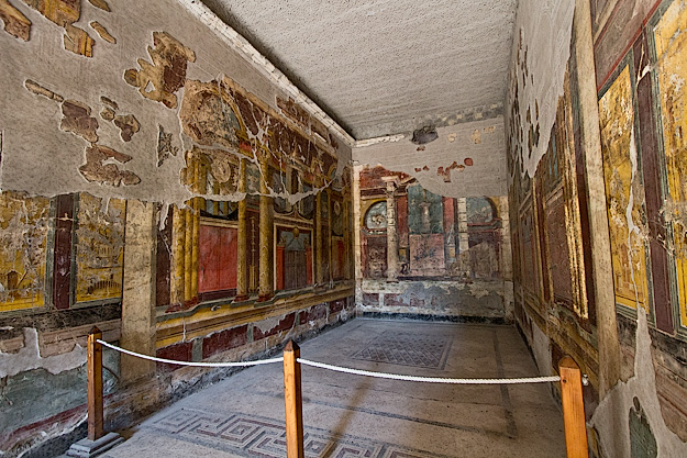 Frescoes adorn the walls of this 'triclinium' - a Roman dining room that would have been furnished with a triple couch