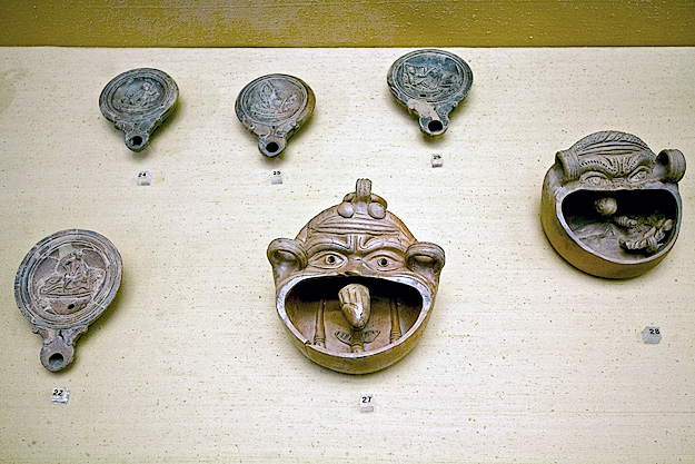 The use of these small terracotta trays is still unknown, though some speculate that they were filled with water, allowing the moveable penis to float and bob