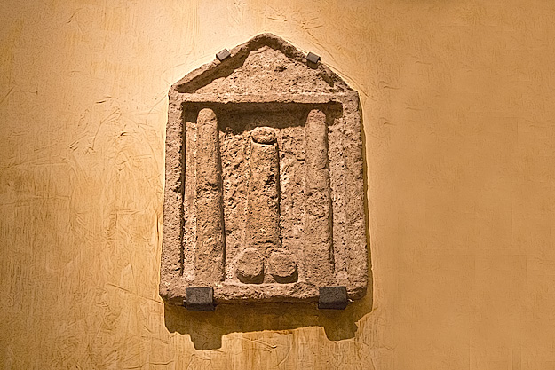 Reliefs of phallic symbols were often hung outside shops to ward off the evil eye or ensure prosperity