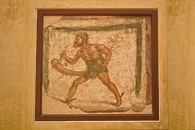 Fresco of Priapus, son of Aphrodite and god of fertility and growth, found in a villa in Pompeii