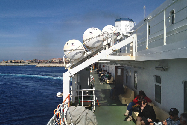 Once the train cars are loaded, the ferry begins the short trip to Messina, Sicily