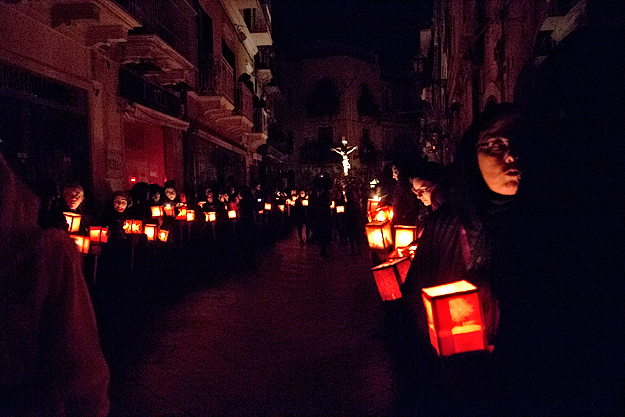 Late into the night, women from all the churches in the town are still filing silently through the dark streets