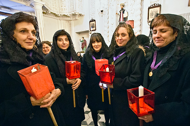 Women of Varo Church await the beginning of the Good Friday Procession