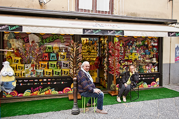 Owners relax in front of Lecce Candy Shop