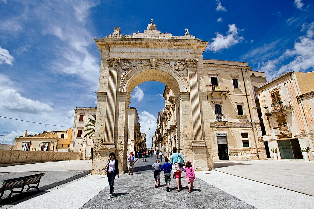 Porta Reale (Royal Gate) stands at the head of Corso Vittorio Emanuele, the main thoroughofare in the Baroque town of Noto, Sicily. It is also known as Porta Ferdinandea, as it was constructed in 1838 to commemorate a visit by King Ferdinand II of Bourbon.