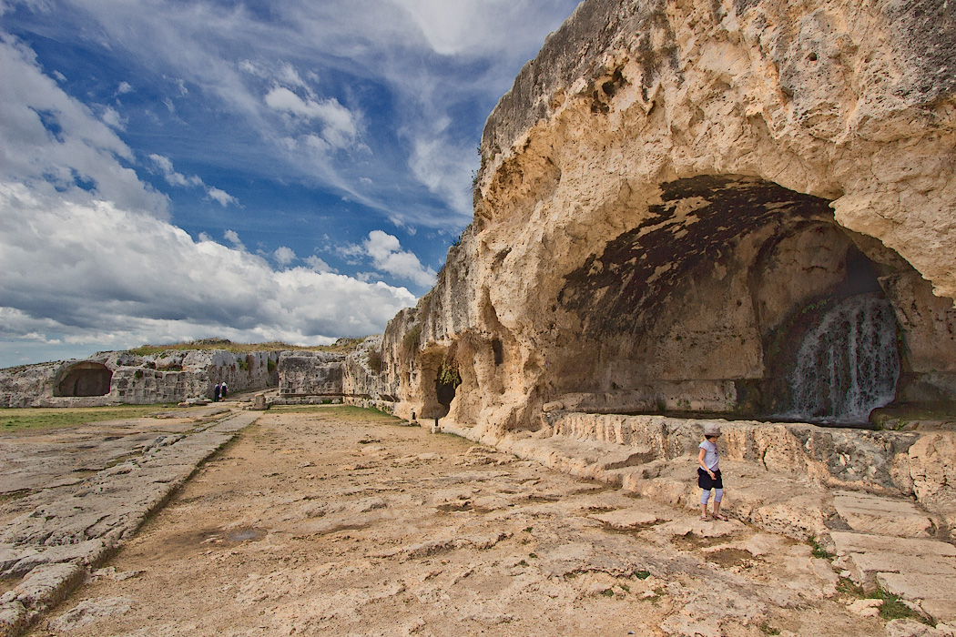 The Nymphaeum, or Grotto of the Nymph, an artificial cave carved into the limestone cliffs above the ancient Greek Amphitheater in Syracuse, Sicily