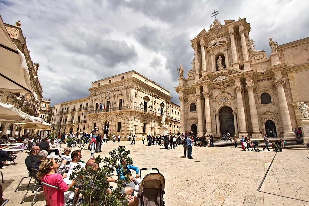 Piazza Duomo, the center of the Old Town area of Syracuse, Sicily, is surrounded by gorgeous Baroque architecture