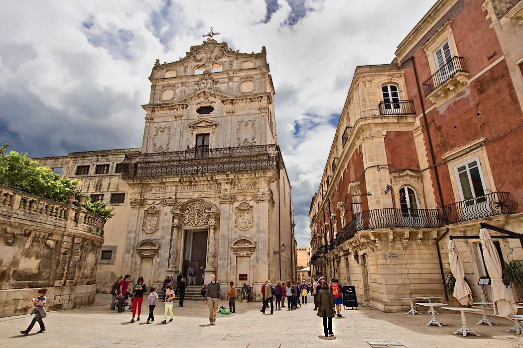 Church of Santa Lucia alla Badia, with its baroque with rococo elements on the facade, anchors one end of exquisite Piazza Duomo in Syracuse, Sicily