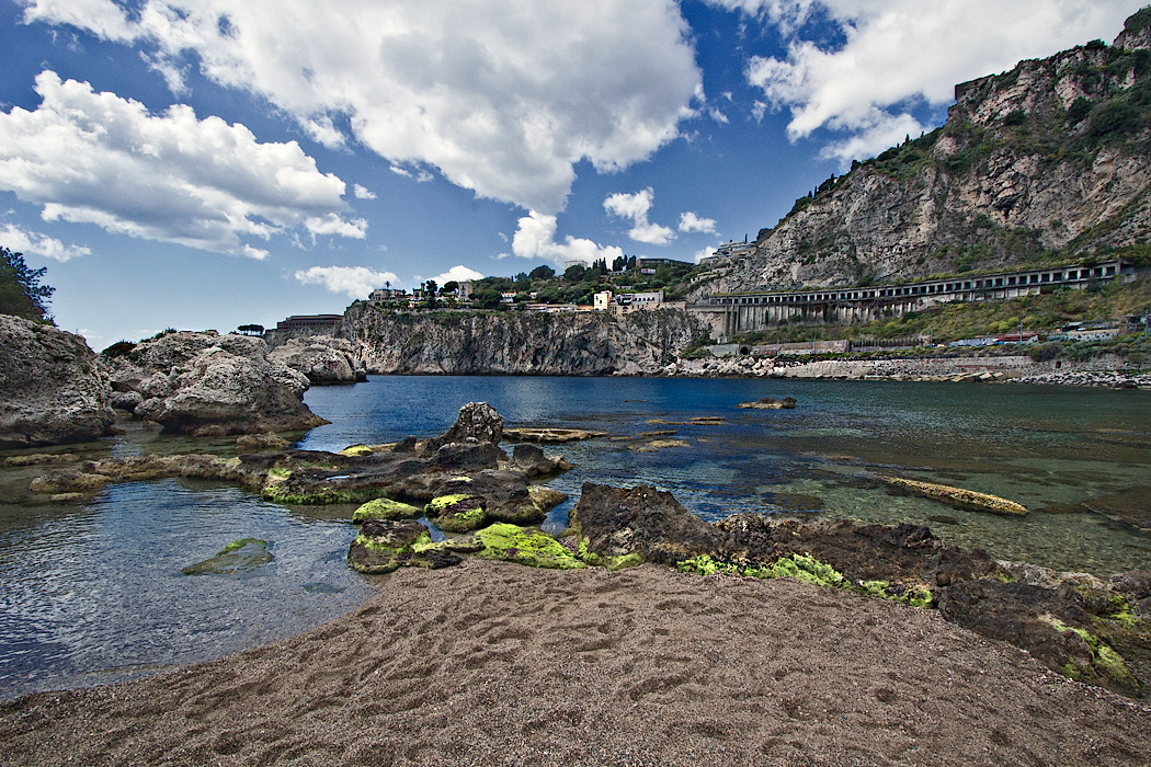 View frm Isola Bella Island, looking toward thecliffs upon which the town of Taormina, Sicily perches